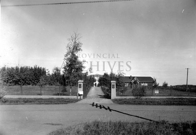 A2606 - View of entrance to the Jewish Cemetery Chapel (visible in the background), located at 7622 - 100 Avenue, Edmonton, Alberta - Before 1945