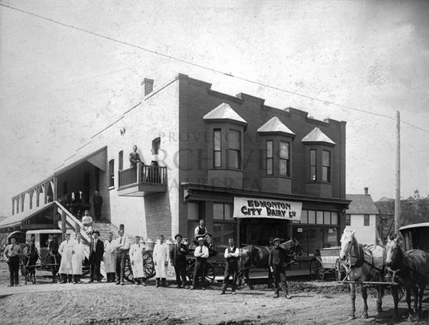 A5284 - Exterior of the Edmonton City Dairy, showing employees outside building. - 1900s