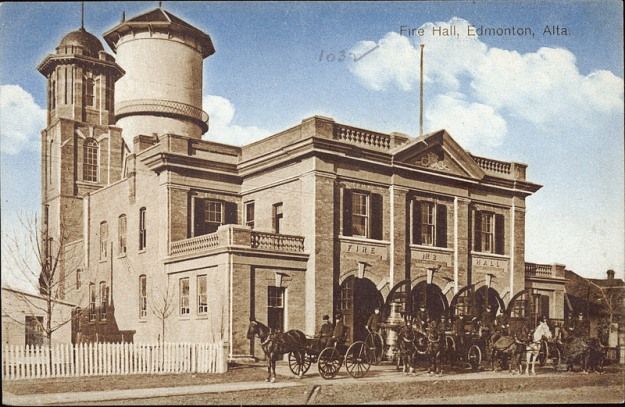 PC006476 - Exterior view of a fire hall, firemen and horse-and-carriages in Edmonton, Alberta. - Fire Hall No. 2 - ca 1910