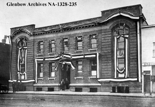 na-1328-235 - Telephone building decorated for visit of Duke of Connaught, Edmonton, Alberta. - 100 Street - September 1912